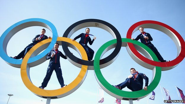 The Great Britain men's Curling team pose with their medals during at the Olympic Park in Sochi, Russia