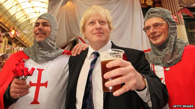 London Mayor Boris Johnson stands with two knights at Leadenhall Market for St George's Day (file photo)