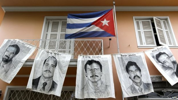 Posters with portraits of five Cubans jailed in the United States are displayed in this 7 April, 2010 file photo in front of Cuba's consulate in Sao Pablo, Brazil