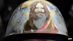 A man wears a helmet with a painting depicting Jesus Christ during a demonstration rally in Kiev on 27 February 2014.