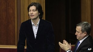Actor Yevhen Nishchuk stands in parliament after being appointed Ukrainian culture minister
