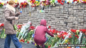 Flowers and candles left for those who died in Kiev