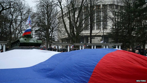Giant Russian flag outside the Crimean parliament building in Simferopol on 27 February 2014