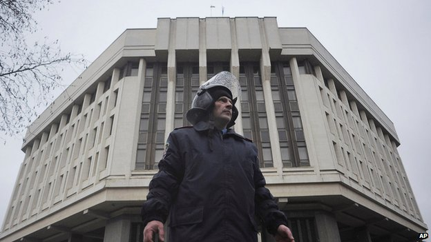 Ukrainian police officer outside a local government building in Simferopol, Crimea, on 27 February 2014