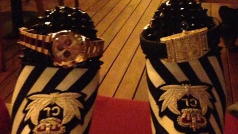A suspect's own photo of what are believed to be high value watches worn on the end of their slippers