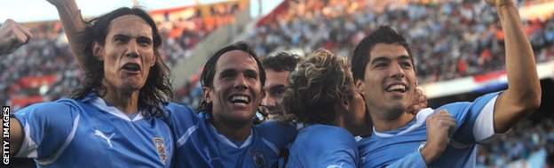 Uruguayans players Edinson Cavani, Alvaro Gonzalez, Diego Forlan and Uruguayan forward Luis Suarez celebrates at the end of the final of the 2011 Copa America football tournament against Paraguay.