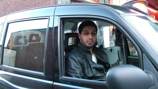 Mohammed Amjad in his cab