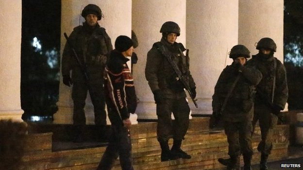 Armed men patrol at the airport in Simferopol, Crimea on 28 February 2014