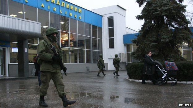 Armed men patrol at the airport in Simferopol, Crimea on 28 February  2014.