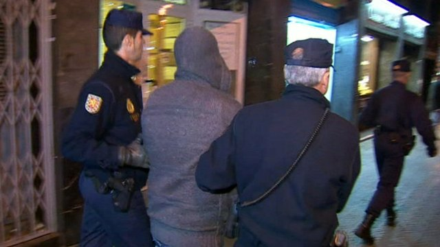 Spanish police arresting a suspected member of a boiler room set-up