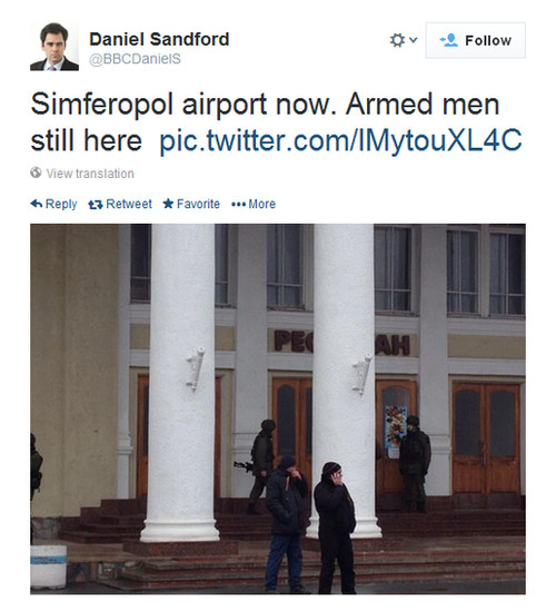 The BBC's Daniel Sandford tweets a picture of armed men at Simferopol airport