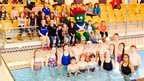 Children meet Games mascot Clyde at the poolside