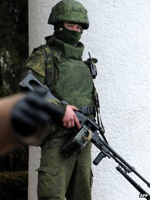 A man in combat uniform armed with a machine-gun outside Simferopol airport, 28 February