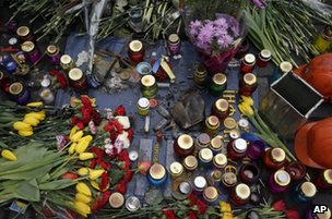 Flowers and candles mark the spot where a protester was killed in a clash with riot police in Kiev