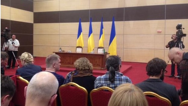 Ukrainian flags hang behind the seat Viktor Yanukovych in the press conference room