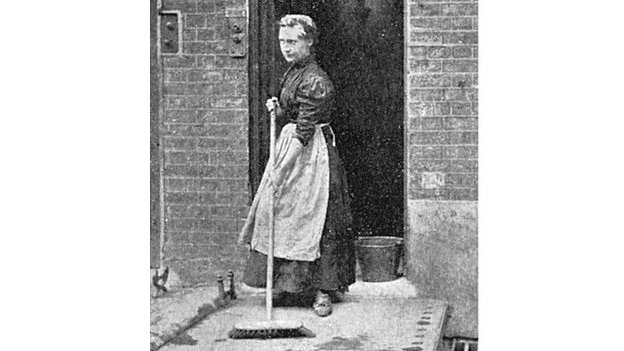 A woman sweeps her floors and the step outside