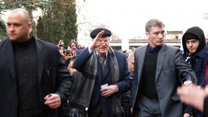 Vladimir Zhirinovsky greets pro-Russian people prior to his eon the main square of Sevastopol on February 28, 2014.