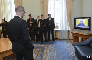Arseniy Yatsenyuk, interim prime minister, watches the Yanukovych news conference from Kiev, 28 February