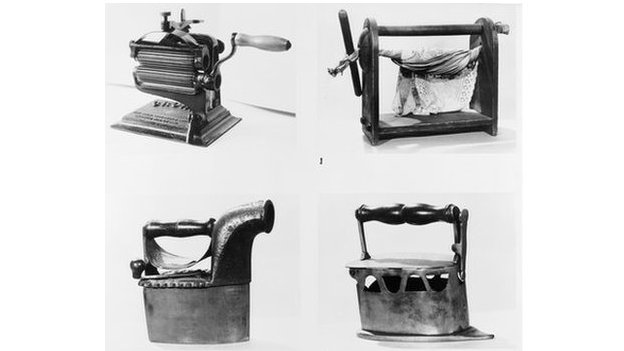 A montage image showing four types of equipment used in laundries at the turn of the century. Clockwise from top, left : a mangle, a wringer, an iron and a steamer.