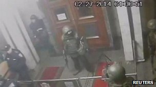 Armed men inside Crimea's parliament in Simferopol on 27 February 2014