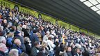 Fans watched the service on big screens inside Deepdale