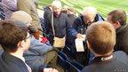 Matt and Harry watch the BBC's Paul Burnell conduct an interview