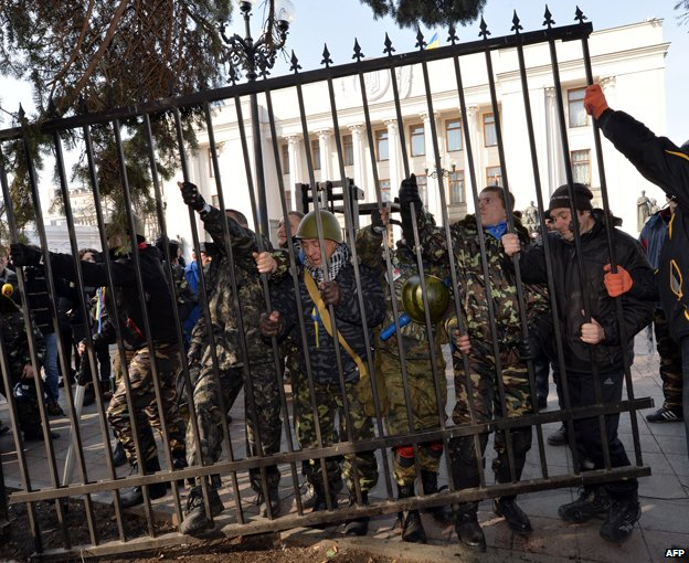Maidan protesters break a fence surrounding the Ukrainian parliament on February 26, 2014