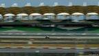 Valentino Rossi steers his bike during a MotoGP pre-season test at the Sepang circuit outside Kuala Lumpur, Malaysia