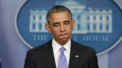 President Obama grimaces during a press conference on the Healthcare.gov website.