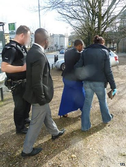 The man and woman being escorted from the register office