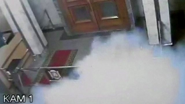 Still from CCTV footage shows smoke rising after an explosion inside Crimea's Regional Parliament Building