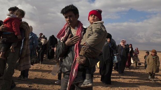 Syrian refugees arriving at a camp in Jordan.