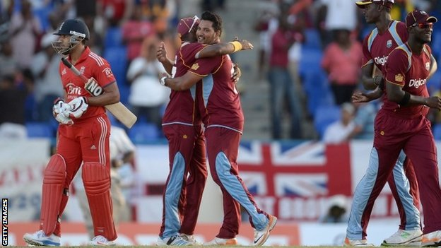 Ravi Bopara of England leaves the field as Dwayne Bravo and Ravi Rampaul of the West Indies celebrates