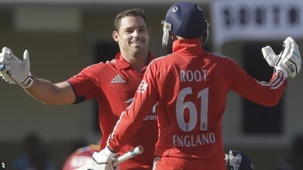 England's Michael Lumb, left, celebrates after he scored a century with Joe Root