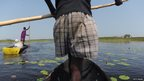 Nuer tribes people pirogue on February 21 through the Sudd swamplands in Unity state, central South Sudan