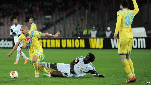 Swansea's Wilfried Bony tries to tackle Gokhan Inler of Napoli