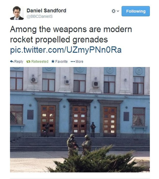 The armed men guarding buildings in Crimea are equipped with military hardware