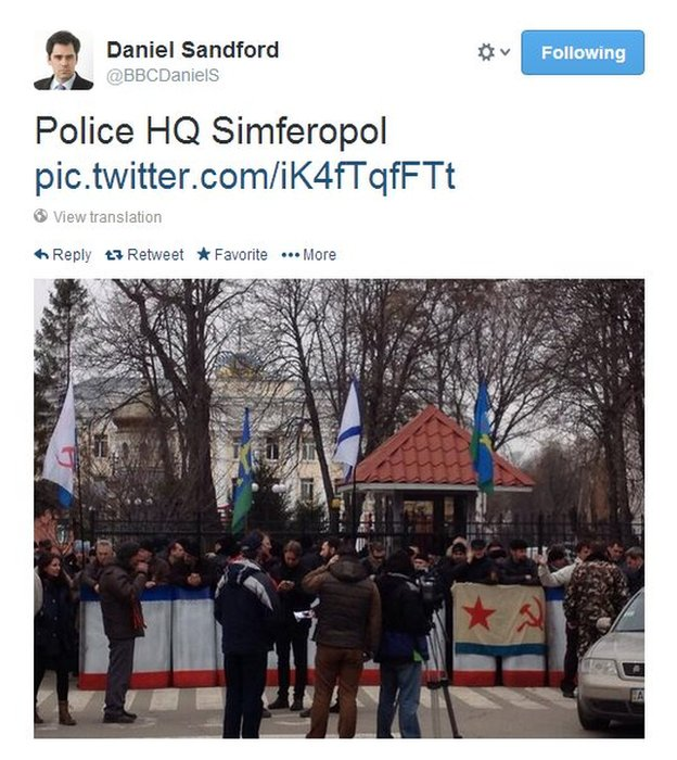 Pro-Russian demonstrators make their point outside the police headquarters in Crimea's capital