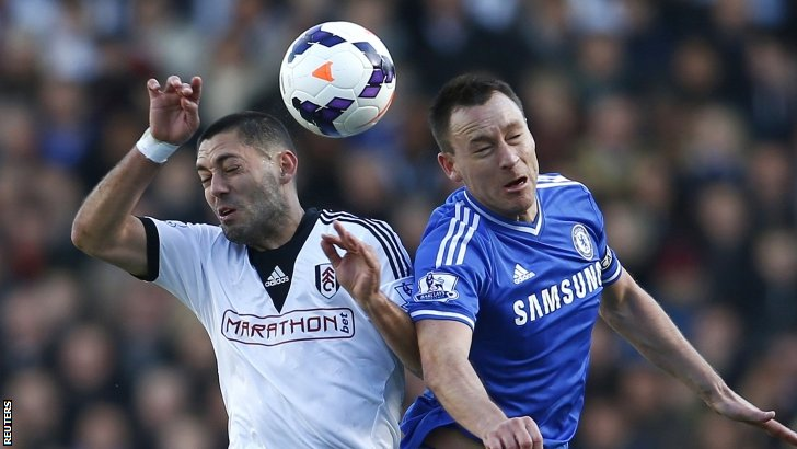 Fulham's Clint Dempsey (left) challenges Chelsea's John Terry