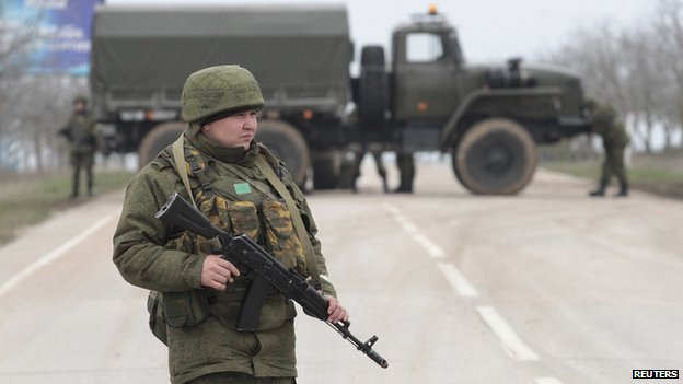 Armed servicemen guard a roadblock at Belbeck Airport near Sevastapol