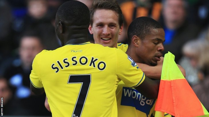 Loic Remy of Newcastle United (right) is congratulated by Moussa Sissoko (left) and Luuk de Jong (centre)