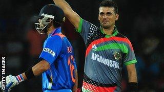 Afghanistan's Dawlat Zadran celebrates dismissing India's Virat Kohli in 2012