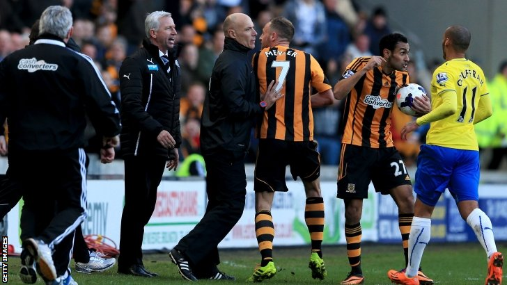 David Meyler is restrained by fourth official Howard Webb as he tries to confront Newcastle boss Alan Pardew