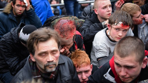 Pro-Western activists, some wounded, after clashes with pro-Russian activists in Kharkiv, Ukraine, on 1 March 2014