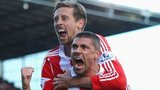 Stoke's Jonathan Walters celebrates with Peter Crouch after scoring against Arsenal