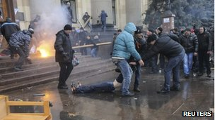 Pro-Russian protesters drag an injured man during clashes with supporters of Ukraine's new government in central Kharkiv.
