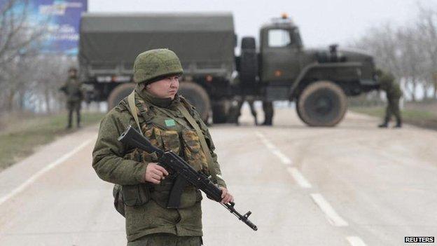 Armed servicemen in Crimea