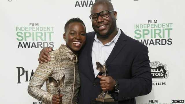 Lupita Nyong'o and Steve McQueen with their  Independent Spirit awards, Santa Monica, 1 March 2014