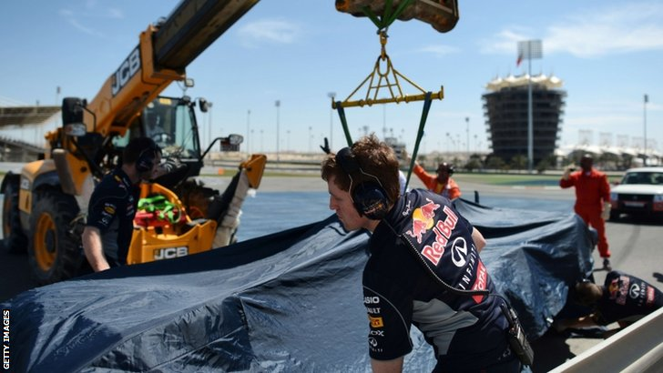 Sebastian Vettel cover the Red Bull in a sheet