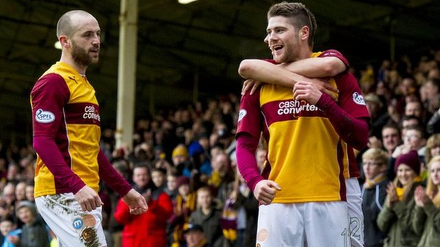 Iain Vigurs is congratulated by his teammates after opening the scoring for Motherwell against Hearts